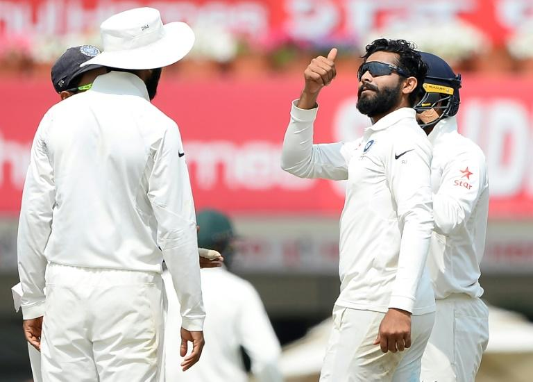 Indian bowler Ravindra Jadeja (2nd right) celebrates with teammates after he dismissed Nathan Lyon (unseen) during the second day of the third Test against Australia in Ranchi, on March 17, 2017