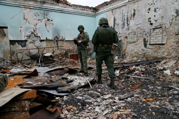 Militants of the self-proclaimed Luhansk People's Republic (LNR) are seen at fighting positions on the line of separation from the Ukrainian armed forces on Tuesday.