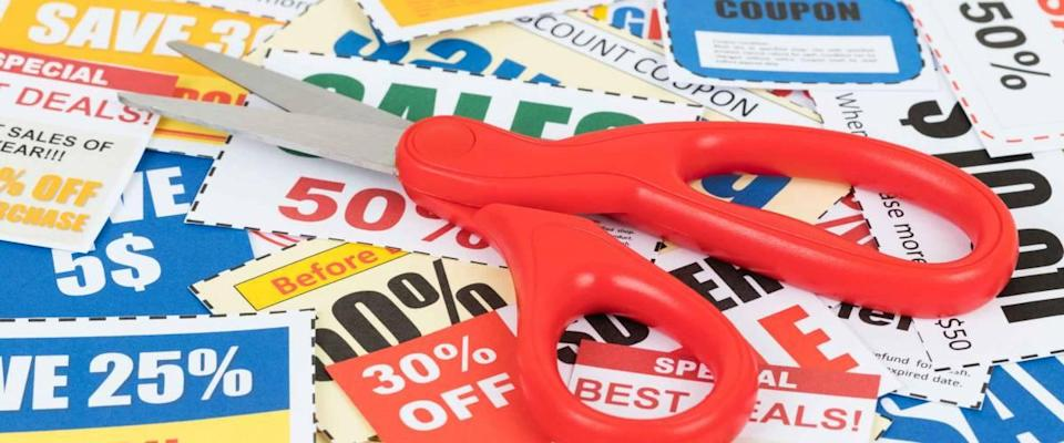 Saving discount coupon voucher with scissor, coupons are mock-up