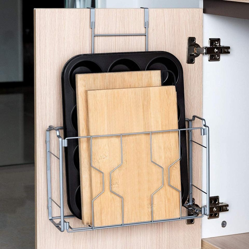 <p>Create extra storage for your bakeware, cutting boards and more with this <span>Auledio 2 Pack Over the Door/Wall Mount Cabinet Organizer Storage Basket</span> ($22).</p>