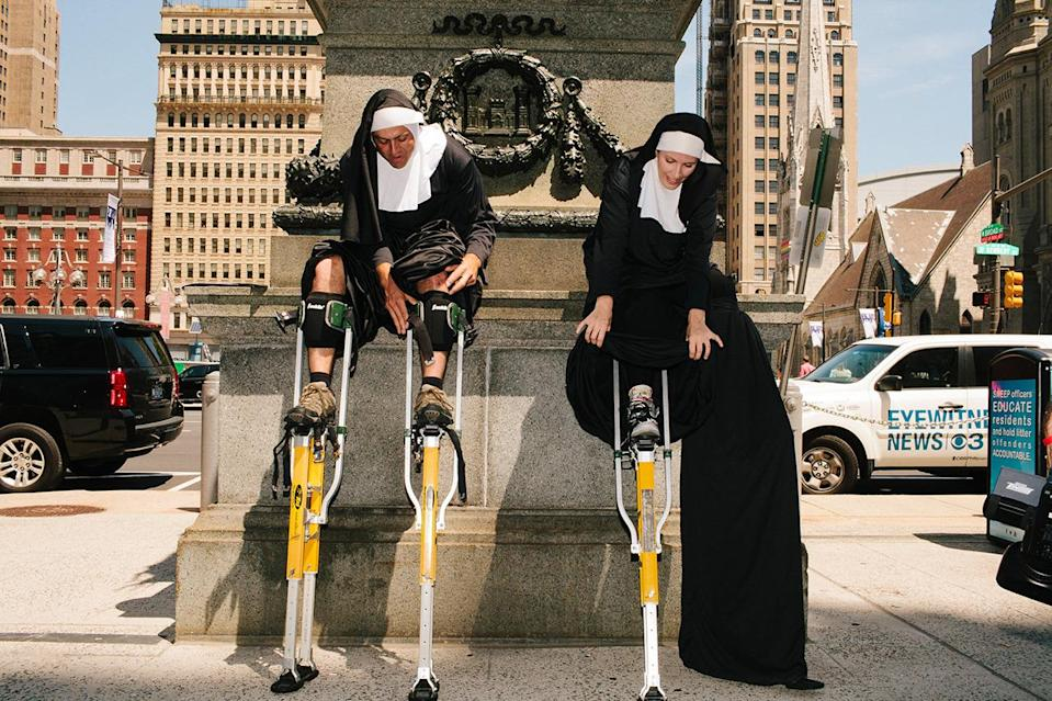 """Two protesters in """"flying nun"""" costumes."""