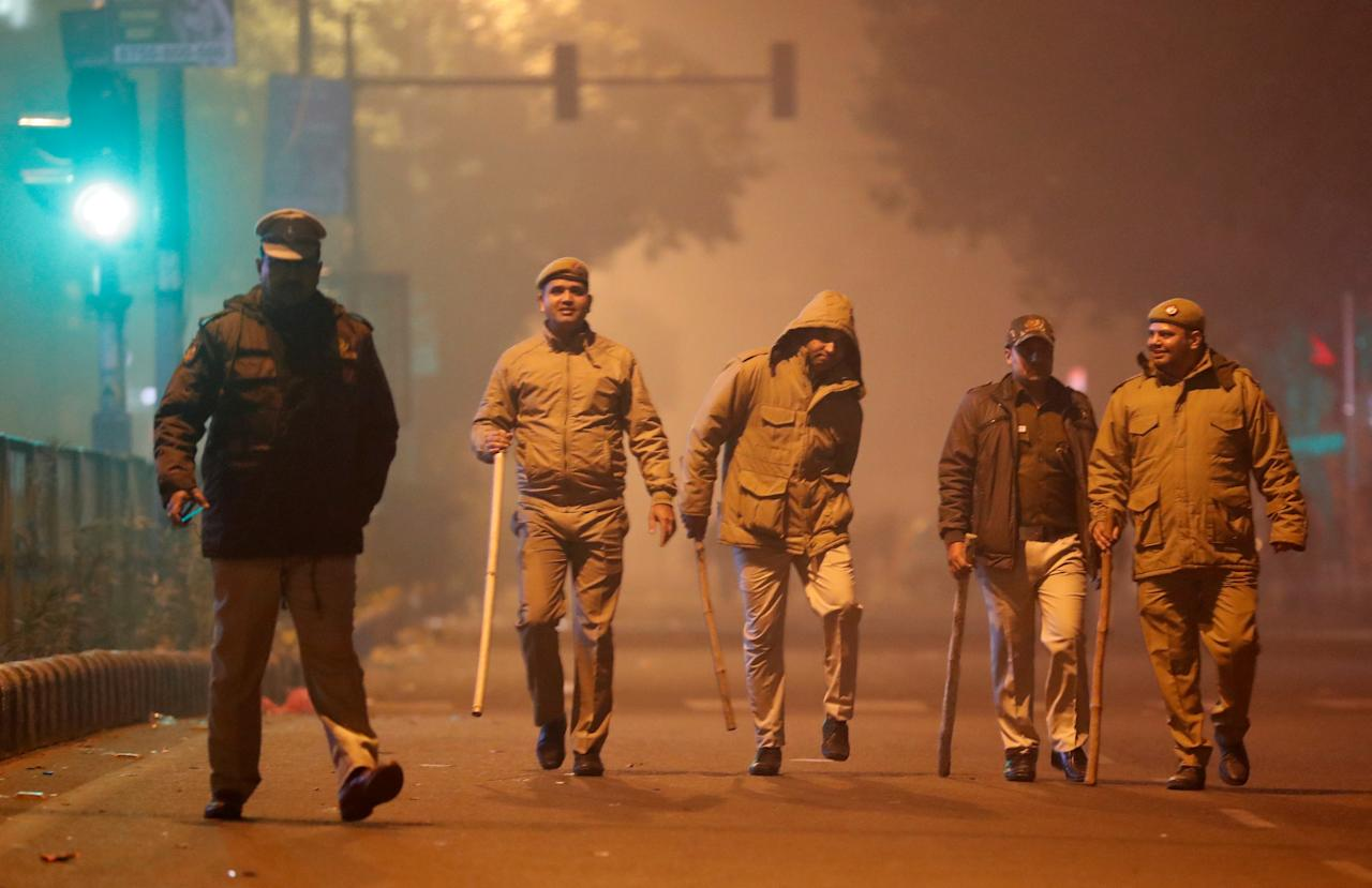 Police officers patrol after a protest against a new citizenship law in Delhi, India, December 20, 2019. REUTERS/Adnan Abidi