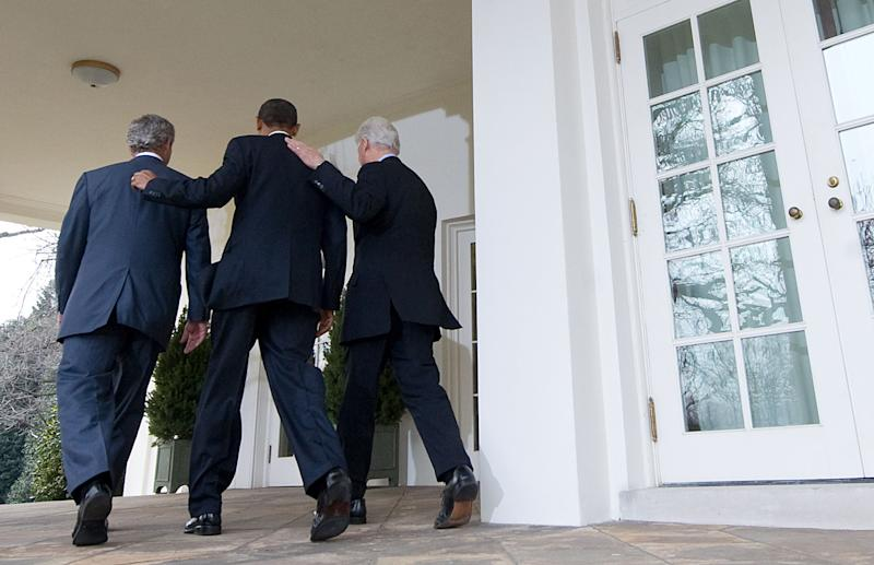 President Barack Obama, center, walks to the Oval Office alongside former Presidents Bill Clinton, right, and George W. Bush, after speaking about relief efforts following the earthquake in Haiti, during a statement in the Rose Garden of the White House in Washington, January 16, 2010.