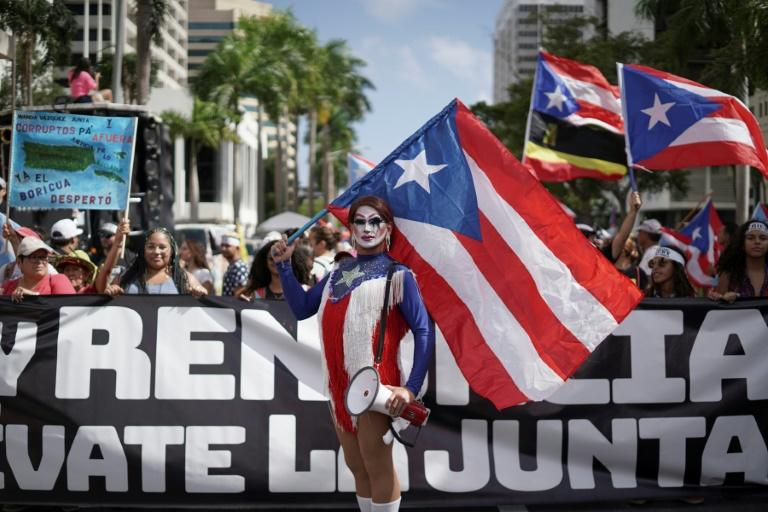 People march in San Juan, Puerto Rico on July 25, 2019, one day after the resignation of Governor Ricardo Rossello