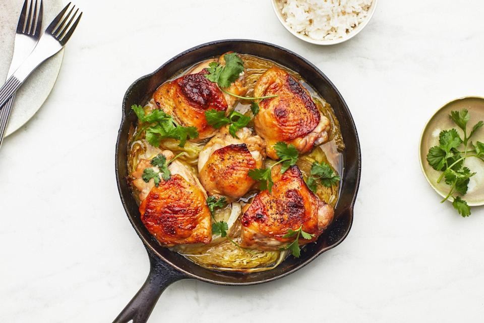 """<a href=""""https://www.bonappetit.com/recipe/thai-roast-chicken-thighs-with-coconut-rice?mbid=synd_yahoo_rss"""" rel=""""nofollow noopener"""" target=""""_blank"""" data-ylk=""""slk:See recipe."""" class=""""link rapid-noclick-resp"""">See recipe.</a>"""