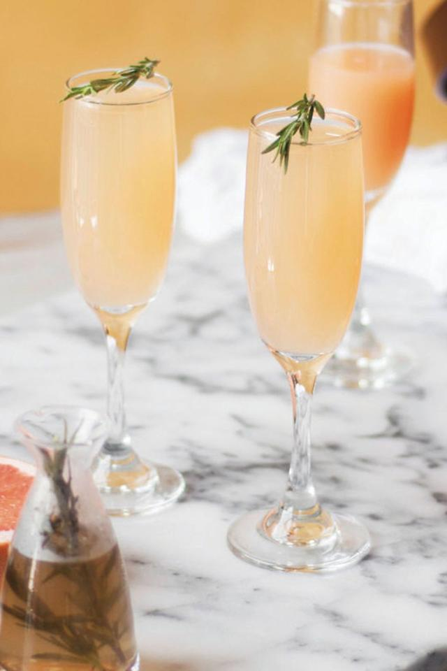 """<p>Give your morning <a href=""""https://www.housebeautiful.com/lifestyle/recipes-cookbooks/g4063/mimosa-recipes/"""" target=""""_blank"""">mimosa</a> recipe a bitter (but delicious) kick by swapping OJ with fresh grapefruit juice. While you're at it, create a picture-worthy <a href=""""https://www.housebeautiful.com/entertaining/holidays-celebrations/g14499690/mimosa-bar/"""" target=""""_blank"""">mimosa bar.</a> </p><p><em><a href=""""http://www.countryliving.com/food-drinks/recipes/a42606/grapefruit-and-rosemary-mimosa/"""" target=""""_blank"""">Get the recipe from Country Living »</a></em></p>"""