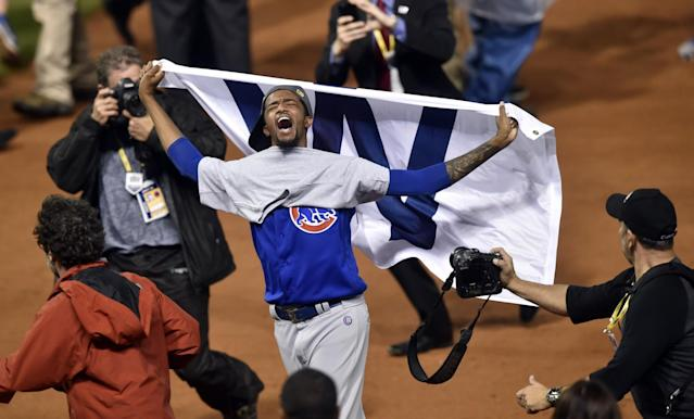 <p>Chicago Cubs relief pitcher Carl Edwards (6) celebrates after defeating the Cleveland Indians in game seven of the 2016 World Series at Progressive Field. Mandatory Credit: David Richard-USA TODAY Sports </p>