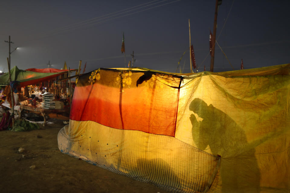 A Hindu pilgrim prays during Magh Mela festival, in Prayagraj, India. Tuesday, Feb. 16, 2021. Millions of people have joined a 45-day long Hindu bathing festival in this northern Indian city, where devotees take a holy dip at Sangam, the sacred confluence of the rivers Ganga, Yamuna and the mythical Saraswati. Here, they bathe on certain days considered to be auspicious in the belief that they be cleansed of all sins. (AP Photo/Rajesh Kumar Singh)