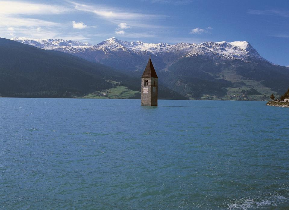 <p>For the last seventy years, the only sign of the lost village of Curon was the curious appearance of a 14th century church spire rising out of the middle of a lake. Now, for the first time in decades, locals around Lago di Resia in South Tyrol, Italy, are walking among the remnants of the old village. Check out these photos of the real-life 2021 Atlantis.<br></p>