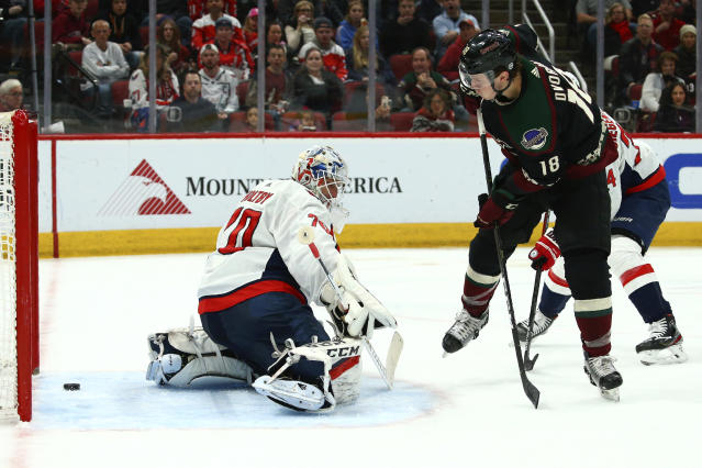 Arizona Coyotes center Christian Dvorak (18) scores a goal against Washington Capitals goaltender Braden Holtby, left, during the second period of an NHL hockey game Saturday, Feb. 15, 2020, in Glendale, Ariz. (AP Photo/Ross D. Franklin)