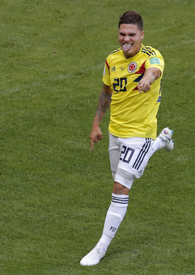Colombia's Juan Quintero, runs to celebrate after scoring his sides first goal during the group H match between Colombia and Japan at the 2018 soccer World Cup in the Mordavia Arena in Saransk, Russia, Tuesday, June 19, 2018. (AP Photo/Vadim Ghirda)