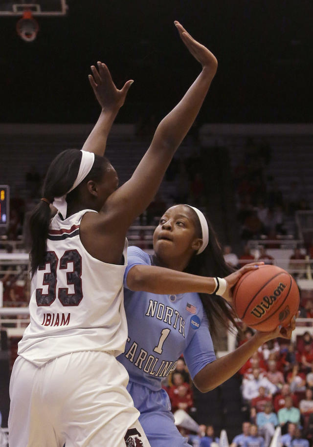 North Carolina forward Stephanie Mavunga (1) is defended by South Carolina center Elem Ibiam (33) during the first half of a regional semifinal game at the NCAA college basketball tournament in Stanford, Calif., Sunday, March 30, 2014. (AP Photo/Jeff Chiu)