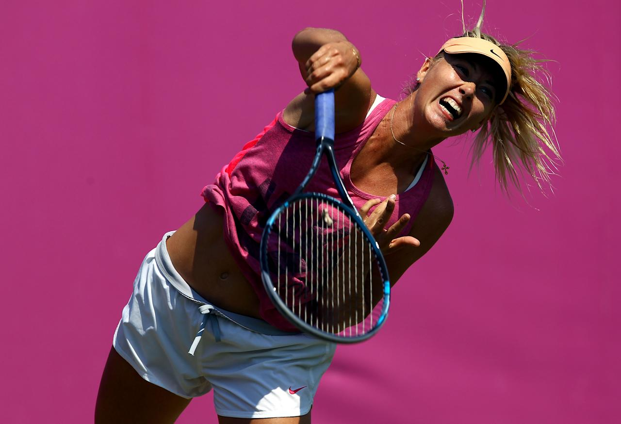LONDON, ENGLAND - JULY 26:  Maria Sharapova of Russia serves during the practice session ahead of the 2012 London Olympic Games at the All England Lawn Tennis and Croquet Club in Wimbledon on July 26, 2012 in London, England.  (Photo by Clive Brunskill/Getty Images)