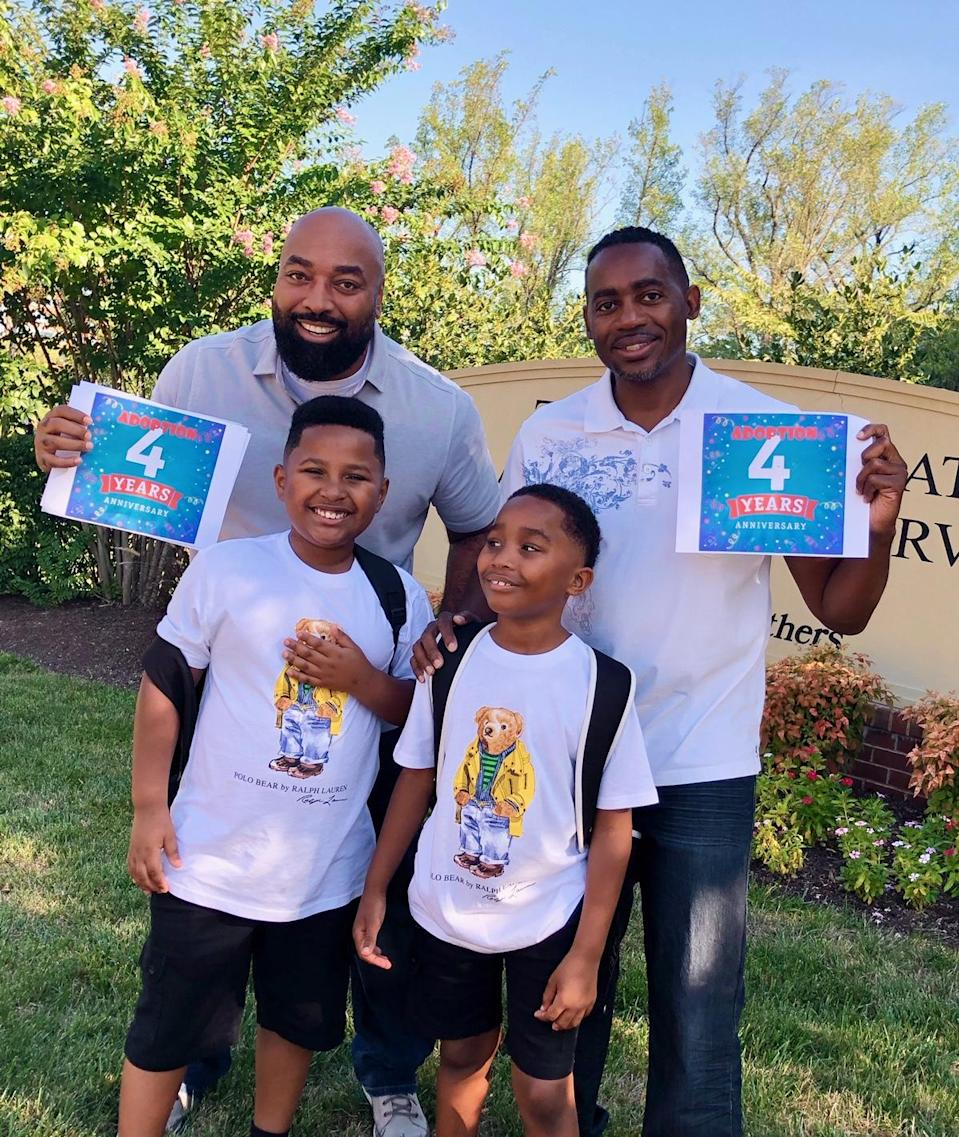 Rodney Chambers, left, and Ron Covington with sons Charles and Carlos. (Photo courtesy of Rodney Chambers)