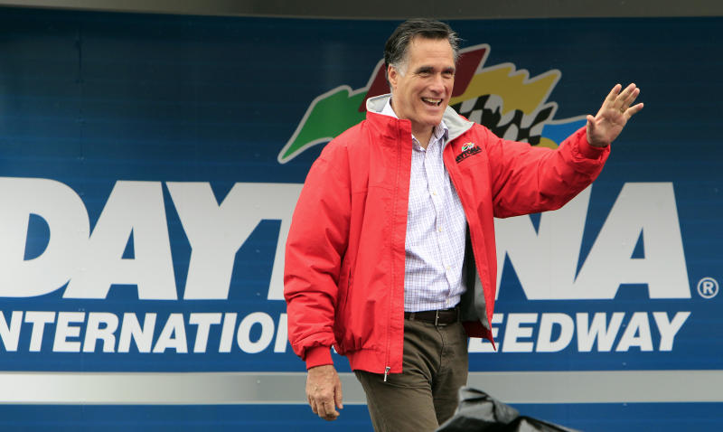 Republican presidential candidate, former Massachusetts Gov. Mitt Romney greets fans during activities before the NASCAR Daytona 500 Sprint Cup series auto race at Daytona International Speedway in Daytona Beach, Fla., Sunday, Feb. 26, 2012. (AP Photo/John Raoux)