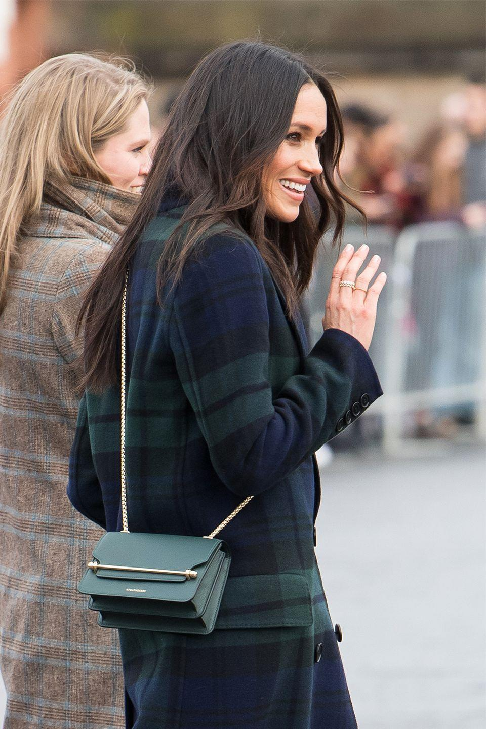 """<p>It's no coincidence that Kate Middleton wears clutches during <em>all</em> of her public outings—<a href=""""https://www.marieclaire.com/celebrity/a17809126/meghan-markle-crossbody-bag-royal-protocol/"""" rel=""""nofollow noopener"""" target=""""_blank"""" data-ylk=""""slk:according to royal expert William Hanson"""" class=""""link rapid-noclick-resp"""">according to royal expert William Hanson</a>, royals opt for clutches over cross-body bags as a sneaky method to avoid shaking hands with fans. On her visit to Edinburgh in February, Meghan made the mistake of choosing a far too practical bag. </p>"""