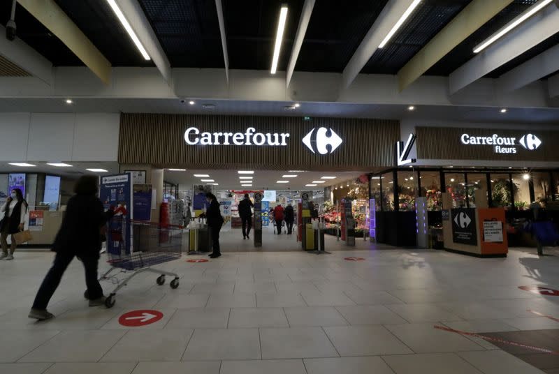 FILE PHOTO: A customer pushes a shopping trolley in a Carrefour Hypermarket store in Nice