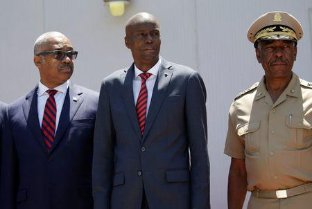 Haitian President Jovenel Moise (C), Prime Minister Jack Guy Lafontant and Chief of the army's high command Jodel Lessage during a ceremony to establish the Joint Chiefs of Staff of the Haitian Armed Forces (FAD'H) in Port-au-Prince, Haiti, March 27, 2018. REUTERS/Andres Martinez Casares