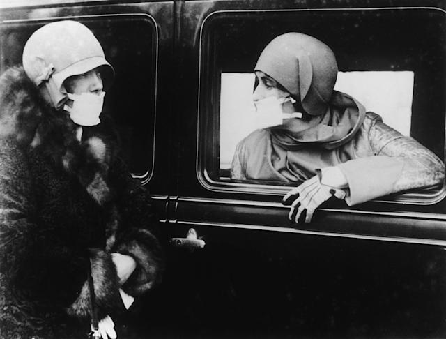Two women wearing masks during the flu pandemic that occurred near the end of World War I. (Keystone/Getty Images)
