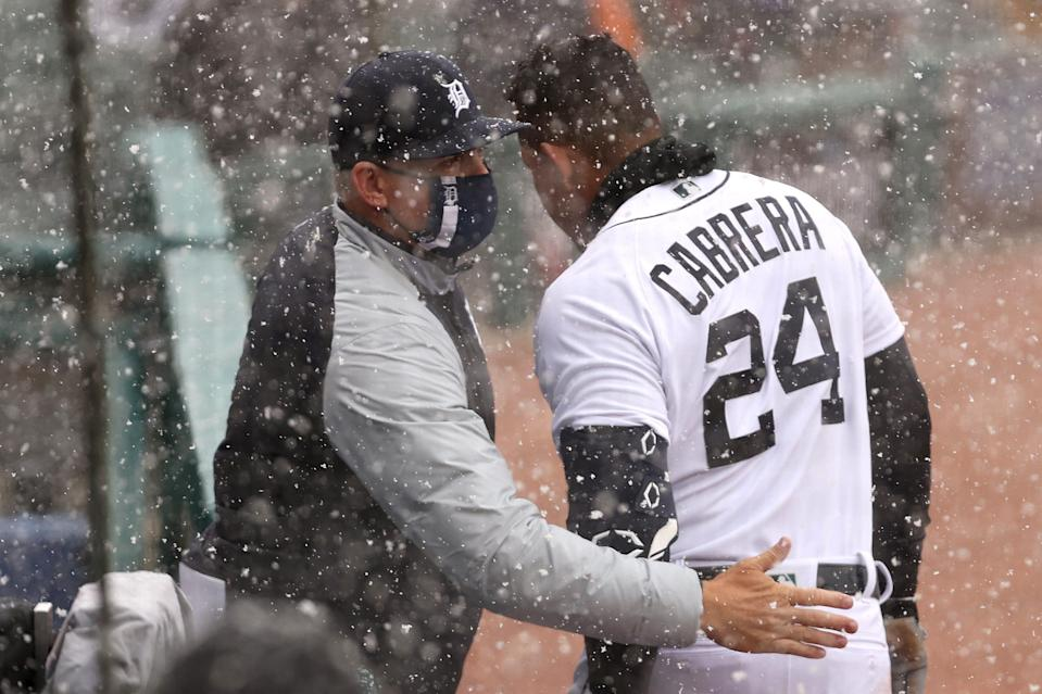 Miguel Cabrera (right) of the Detroit Tigers celebrates his first inning two run home run with manager A.J. Hinch.