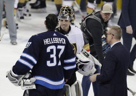 May 20, 2018; Winnipeg, Manitoba, CAN; Winnipeg Jets goaltender Connor Hellebuyck (37) shakes hands with Vegas Golden Knights goaltender Marc-Andre Fleury (29) after game five of the Western Conference Final of the 2018 Stanley Cup Playoffs at Bell MTS Place. Mandatory Credit: James Carey Lauder-USA TODAY Sports