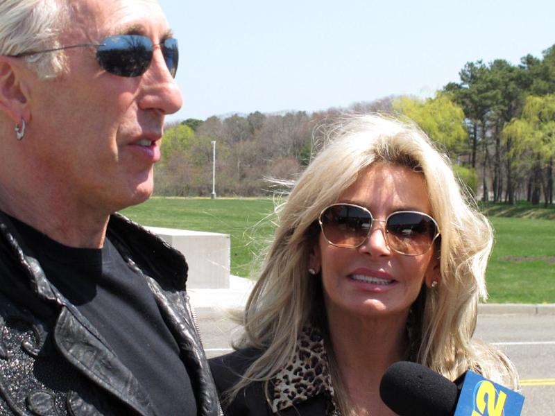 Dee Snider, lead singer of the rock band Twisted Sister, stands with his wife Suzette Snider outside U.S. District Court in Central Islip, N.Y., on Wednesday, April 24, 2013. The couple attended the sentencing of a man convicted of conspiracy and murder in the deaths of Suzette Snider's brother and two other men. (AP Photo/Frank Eltman)