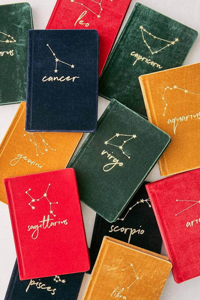 "<p>The <a href=""https://www.popsugar.com/buy/Velvet-Zodiac-Journal-518436?p_name=Velvet%20Zodiac%20Journal&retailer=urbanoutfitters.com&pid=518436&price=14&evar1=tres%3Auk&evar9=36098283&evar98=https%3A%2F%2Fwww.popsugar.com%2Flove%2Fphoto-gallery%2F36098283%2Fimage%2F46906162%2FVelvet-Zodiac-Journal&list1=gifts%2Choliday%2Cgift%20guide%2Castrology%2Choliday%20living&prop13=api&pdata=1"" rel=""nofollow"" data-shoppable-link=""1"" target=""_blank"" class=""ga-track"" data-ga-category=""Related"" data-ga-label=""https://www.urbanoutfitters.com/shop/velvet-zodiac-journal?category=SEARCHRESULTS&amp;color=804"" data-ga-action=""In-Line Links"">Velvet Zodiac Journal</a> ($14) will inspire anyone to write with its soft velvet cover. </p>"