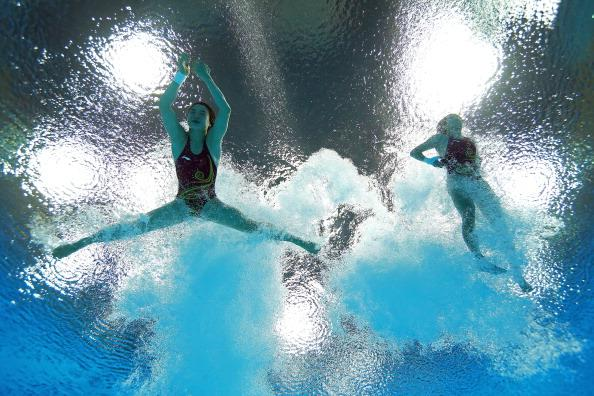 LONDON, ENGLAND - JULY 31:  Hao Wang and Chen Roulin of China compete in the Women's Synchronised 10m Platform Diving on Day 4 of the London 2012 Olympic Games at the Aquatics Centre on July 31, 2012 in London, England.  (Photo by Al Bello/Getty Images)