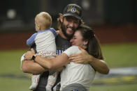 Los Angeles Dodgers starting pitcher Clayton Kershaw celebrates with family after defeating the Tampa Bay Rays 3-1 to win the baseball World Series in Game 6 Tuesday, Oct. 27, 2020, in Arlington, Texas. (AP Photo/Eric Gay)