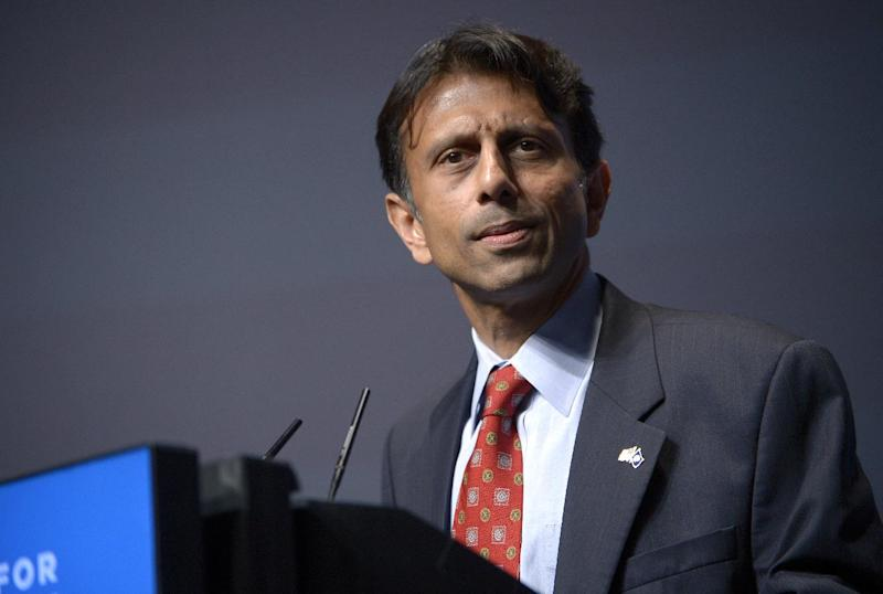 """FILE - In this Aug. 30, 2013, file photo, Louisiana Gov. Bobby Jindal addresses attendees during the Americans for Prosperity Foundation's Defending the American Dream Summit in Orlando, Fla. With no end in sight to the federal government shutdown, Republican governors eyeing the 2016 presidential race are pitching themselves as can-do politicians and highlighting records of achievement. """"Republican governors are not going to take it anymore,"""" says Jindal, among those state leaders and potential presidential candidates using the shutdown to try to position themselves as outsiders at a time of voter disgust with Congress and anyone connected with Washington. (AP Photo/Phelan M. Ebenhack)"""