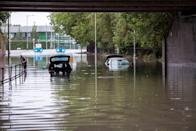 Cars are seen trapped in flood water on Crossley Road near Levenshulme following heavy rainfall overnight on July 28, 2019 in Manchester, England (Picture: Getty)