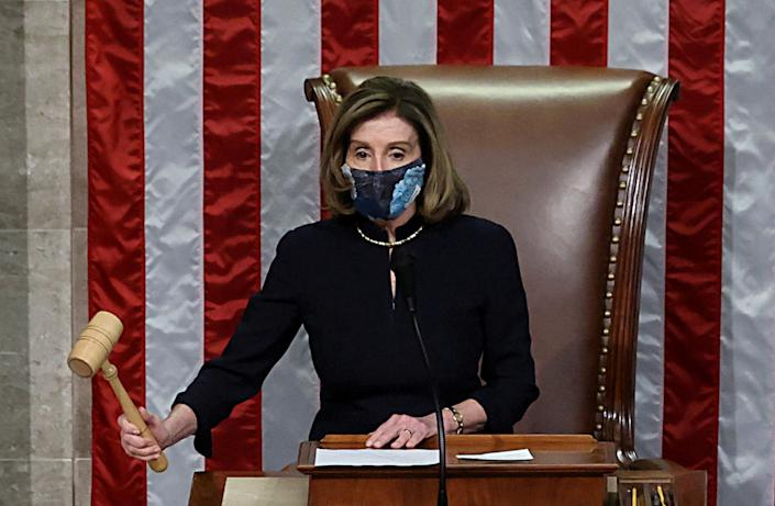 US House Speaker Nancy Pelosi presides over the vote to impeach president Donald Trump for a second time on Wednesday. Photo: Jonathan Ernst/Reuters