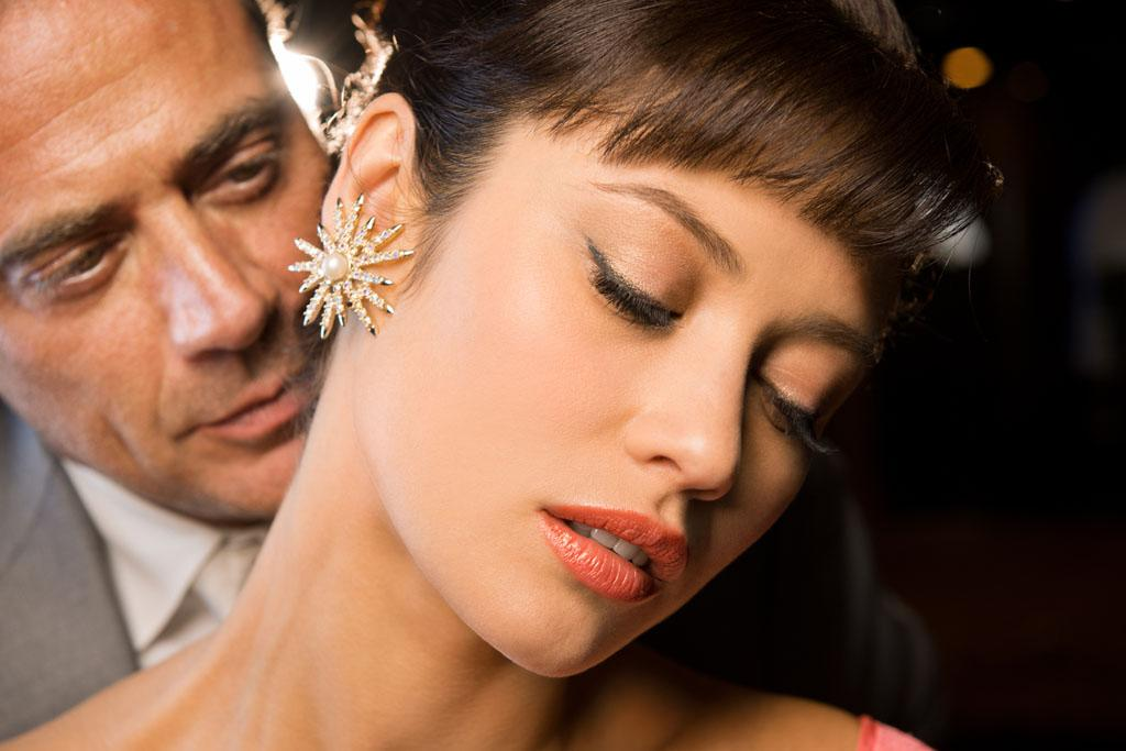 "Jeffrey Dean Morgan as Ike Evans and Olga Kurylenko as Vera Evans in ""Magic City"" Season 2."