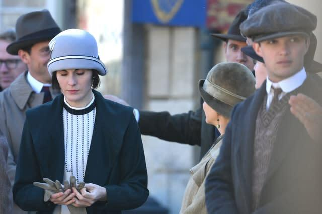 Michelle Dockery on the Downton Abbey film set in Lacock, Wiltshire (Ben Birchall/PA)
