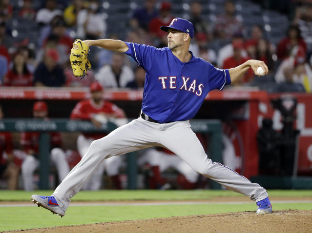 Texas Rangers starting pitcher Mike Minor throws to the Los Angeles Angels during the first inning of a baseball game Monday, Sept. 10, 2018, in Anaheim, Calif. (AP Photo/Marcio Jose Sanchez)