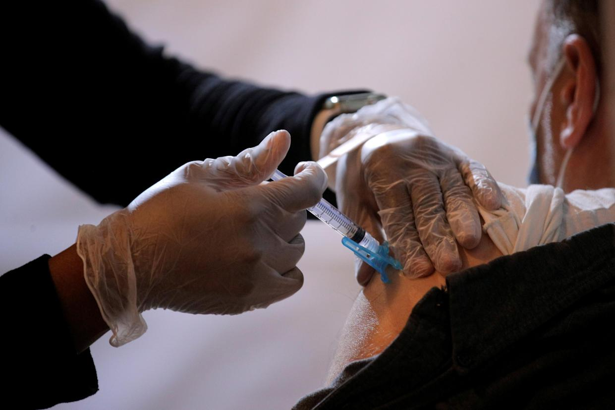 A commuter receives a shot of the Johnson & Johnson vaccine for the coronavirus disease (COVID-19) during the opening of MTA's public vaccination program at a subway station in the Brooklyn borough of New York City on May 12, 2021. (Brendan McDermid/Reuters)
