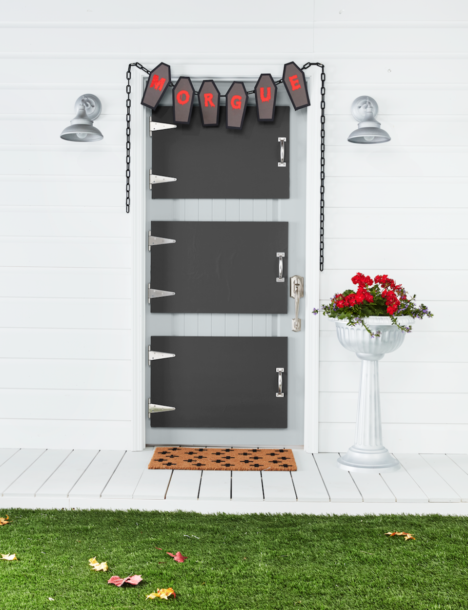 "<p>Although there are many ways to turn your door into a spooky entrance, we think this morgue idea is the creepiest of them all. </p><p><strong>Make the Morgue Door</strong><strong>: </strong>Attach three precut 20- by 30-inch pieces of foam core together with spray adhesive. Attach a piece of black paper, cut to size, to the top piece of foam core using spray adhesive. Insert the rectangular piece of two 6-inch stainless steel T-hinges between the first and second pieces of foam core on one of the short sides; ""screw"" in place. Place a 6 1/2-inch handle on the opposite side; ""screw"" in place. Cover exposed edges of the foam core with silver duct tape, folding any excess to the back. Make two more doors. Adhere to house door with heavy- duty self-adhesive Velcro. Cut five coffin shapes from black and gray kraft paper. Paint letters on gray coffins with red acrylic paint to spell ""morgue"" and attach to black coffins with double-sided tape. Hang a plastic chain above the door and attach coffin cutouts with hot-glue. Add plastic pedestal planter painted Titanium Silver by Rust-Oleum and ""Swiss Cross"" doormat.</p><p><a class=""link rapid-noclick-resp"" href=""https://www.amazon.com/Arteza-Boards-Lightweight-Presentations-Projects/dp/B07B867PJR/?tag=syn-yahoo-20&ascsubtag=%5Bartid%7C10050.g.22350299%5Bsrc%7Cyahoo-us"" rel=""nofollow noopener"" target=""_blank"" data-ylk=""slk:SHOP FOAM CORE BOARD"">SHOP FOAM CORE BOARD</a></p>"