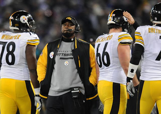 Pittsburgh Steelers coach Mike Tomlin stands on the sideline during an official play review in the second half of an NFL football game against the Baltimore Ravens, Thursday, Nov. 28, 2013, in Baltimore. Baltimore won 22-20. (AP Photo/Gail Burton)