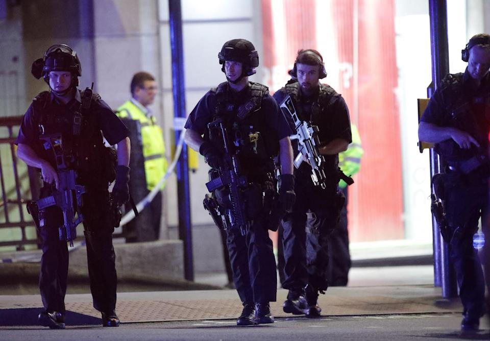 <p>Armed police outside Monument station as police are responding to three incidents in the capital, amid reports that a vehicle collided with pedestrians on London Bridge. Officers are dealing with reports of stabbings in Borough Market, where armed officers attended and shots were fired. (Press Association) </p>