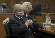 Robert Durst attorney's Dick Deguerin, left, and David Chesnoff listen to the verdict being read by Los Angeles Superior Court Judge Mark E. Windham in court Friday, Sept. 17, 2021 in Inglewood, Calif. A Los Angeles jury convicted Robert Durst on Friday of murdering his best friend 20 years ago, a case that took on new life after the New York real estate heir participated in a documentary that connected him to the slaying that was linked to his wife's 1982 disappearance. (Genaro Molina/Los Angeles Times via AP, Pool)