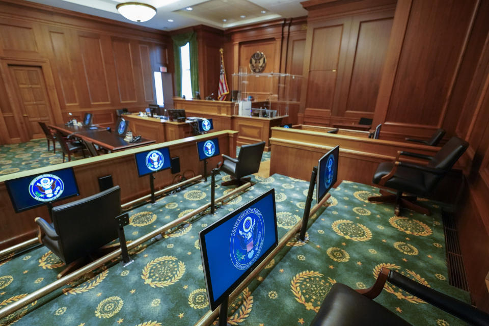 An expanded jury box with socially-distanced seating and individual screens for each juror are seen in a courtroom at a Manhattan federal courthouse, Friday, March 12, 2021, in New York. What is arguably the nation's busiest and largest federal courthouse complex took the adage that justice delayed is justice denied to heart when COVID hit. Now, dozens of jury trials in Manhattan are planned with a safety system so extensive that no document will change hands without being sprayed with disinfectant. (AP Photo/Mary Altaffer)