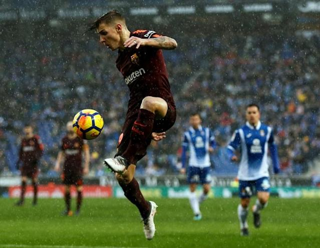 Barcelona's defender Lucas Digne controls the ball during the Spanish league football match between RCD Espanyol and FC Barcelona at the RCDE Stadium in Cornella de Llobregat