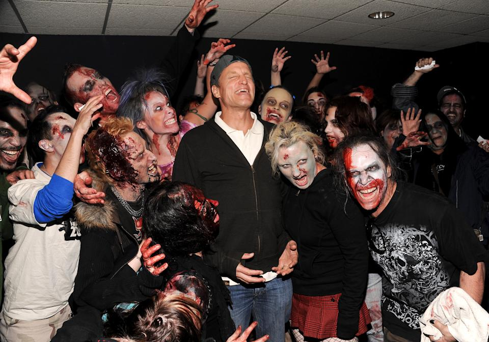 Actor Woody Harrelson poses with zombies at a special screening of the film 'Zombieland' at the AMC Empire Theater on Wednesday, Sept. 30, 2009 in New York. (AP Photo/Evan Agostini)