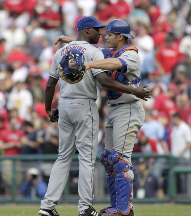 CORRECTS SDAY AND DATE TO SUNDAY SEPT. 22 - New York Mets' LaTroy Hawkins, left and Anthony Recker celebrate after Philadelphia Phillies' Jimmy Rollins struck out to end the ninth inning of a baseball game Sunday, Sept. 22, 2013, in Philadelphia. The Mets won 4-3. (AP Photo/H. Rumph Jr)