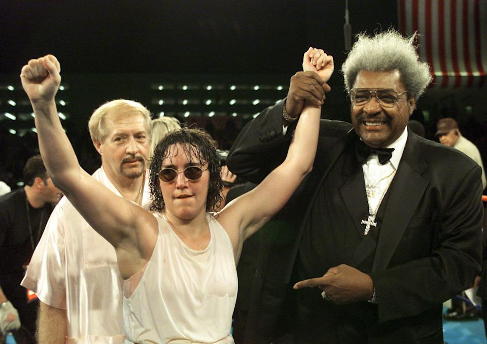 3 Mar 2000:  Promoter Don King holds up the arm of Christy Martin after defeating Belinda Laracuente by way of unanimous decision after 8 rounds during their Women''s WBC Championship bout at Caesars Palace in Las Vegas, Nevada.  <<DIGITAL IMAGE>>   Mandatory Credit: Jed Jacobsohn/ALLSPORT