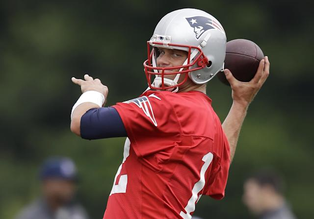 New England Patriots quarterback Tom Brady winds up for a pass during an NFL football training camp practice at Gillette Stadium, Thursday, July 24, 2014, in Foxborough, Mass. (AP Photo)