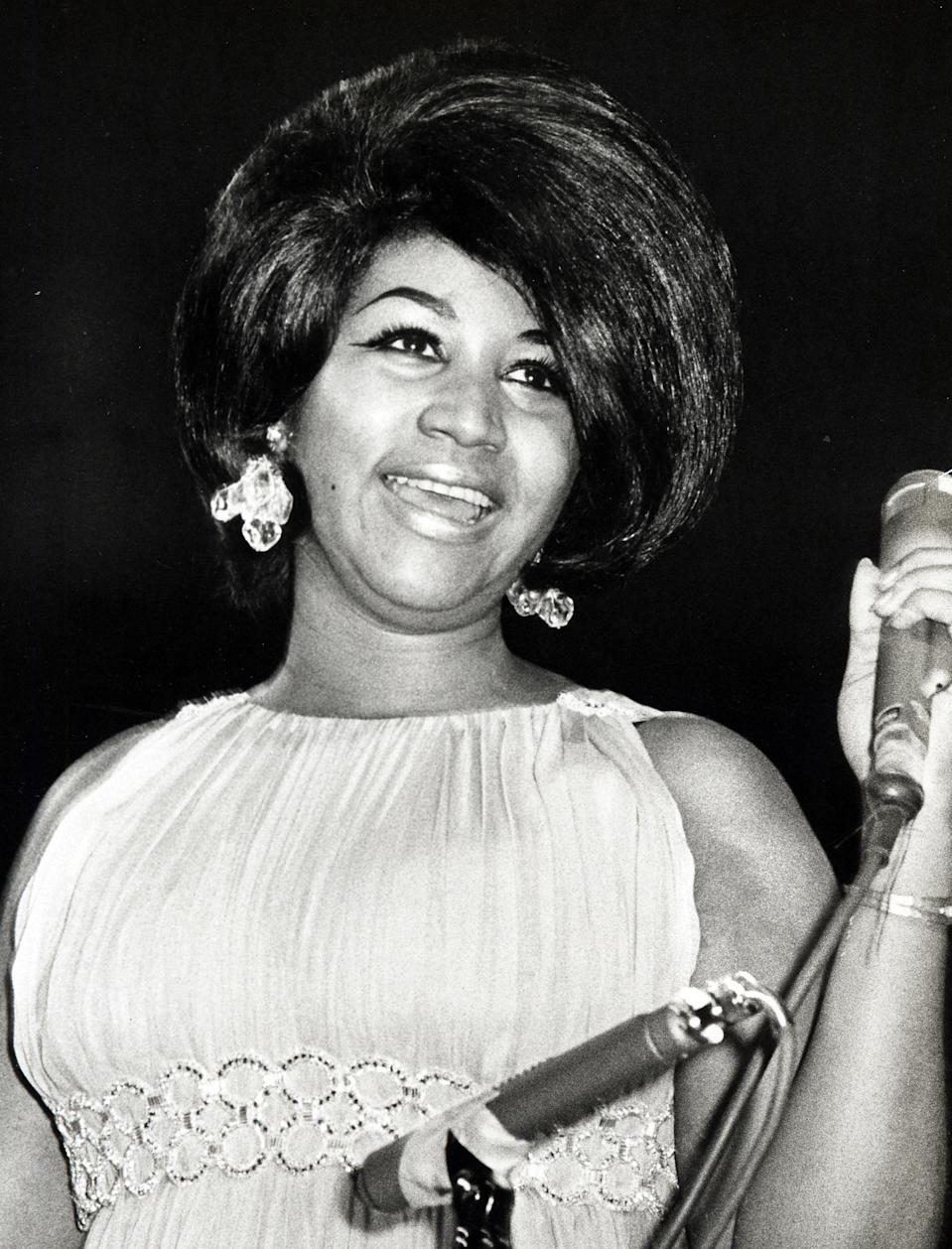 <p>Aretha Franklin wears a pleated empire dress with crystal earrings and glamourous hair at the Martin Luther King Benefit. (Photo by Getty Images) </p>