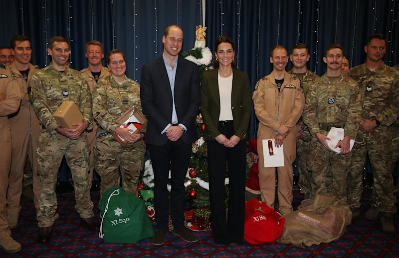 Prince William, Duke of Cambridge and Catherine, Duchess of Cambridge visit military personnel and hand out gifts. (WPA Pool via Getty Images)
