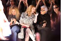 <p>Super chic in head-to-toe black, Iris Apfel sits front row at a fashion show during New York Fashion Week. While not usually her modus operandi to don all-black, the variety of textures keep the ensemble true to her distinct style.<br></p>