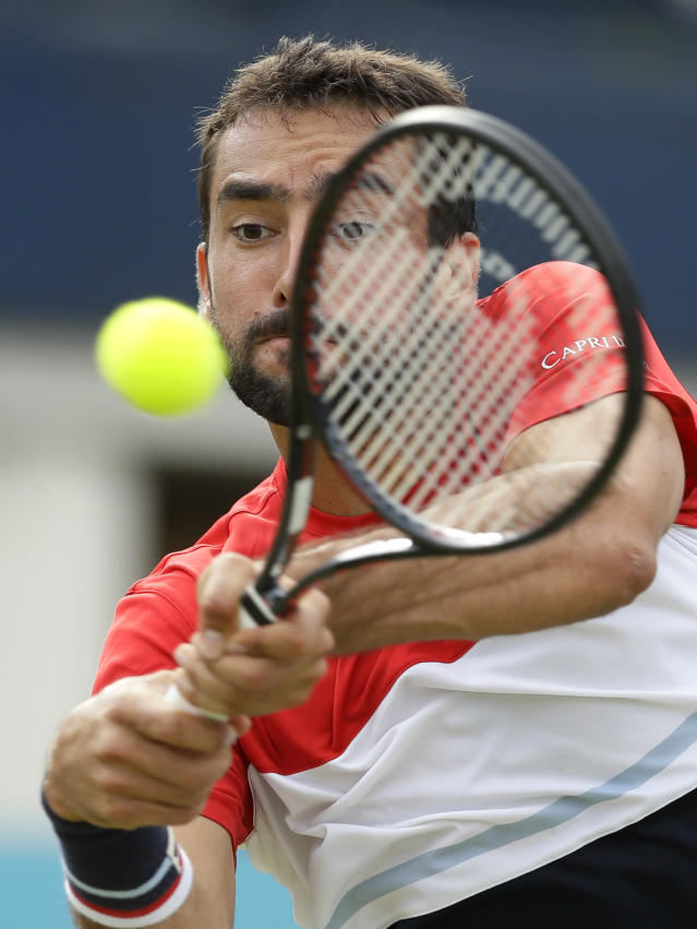 Marin Cilic of Croatia plays a return to Gilles Muller of Luxembourg during their singles tennis match at the Queen's Club tennis tournament in London, Wednesday, June 20, 2018. (AP Photo/Kirsty Wigglesworth)